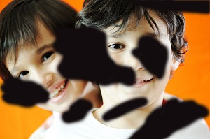 Portrait of two children smiling. The image is covered with black 'floating clouds' to illustrate the impact of diabetic retinopathy on vision.